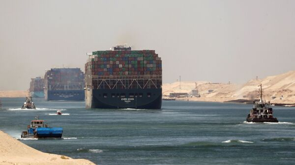 FILE PHOTO: Ever Given, one of the world's largest container ships, sets sail to leave through Suez Canal after the canal authority reached a settlement with the vessel's owner and insurers, in Ismailia, Egypt, July 7, 2021. - Sputnik International
