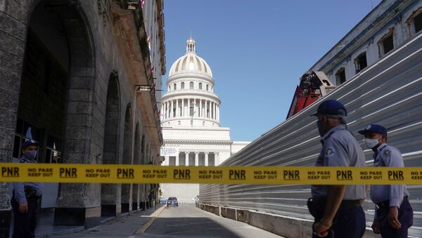 A police line is seen blocking a road leading to the National Capitol Building, in Havana, Cuba, July 12, 2021.  - Sputnik International
