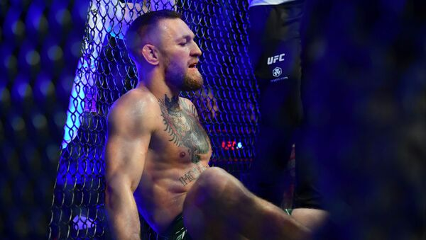Jul 10, 2021; Las Vegas, Nevada, USA; Conor McGregor reacts following an injury suffered against Dustin Poirier during UFC 264 at T-Mobile Arena. - Sputnik International