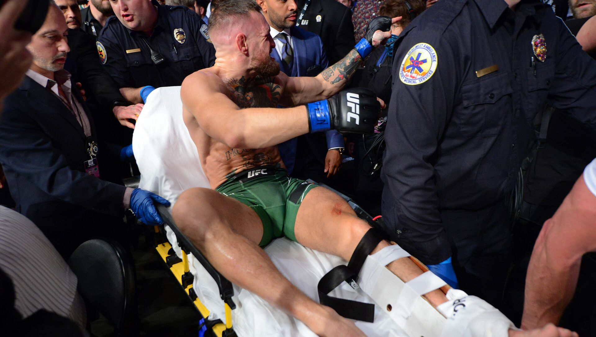 Jul 10, 2021; Las Vegas, Nevada, USA; Conor McGregor is carried off a stretcher following an injury suffered against Dustin Poirier during UFC 264 at T-Mobile Arena. - Sputnik International, 1920, 02.08.2021