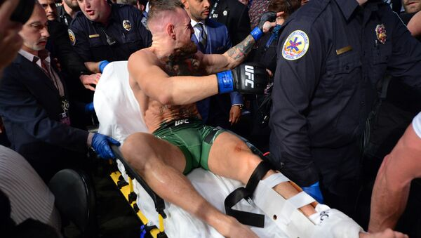 Jul 10, 2021; Las Vegas, Nevada, USA; Conor McGregor is carried off a stretcher following an injury suffered against Dustin Poirier during UFC 264 at T-Mobile Arena. - Sputnik International