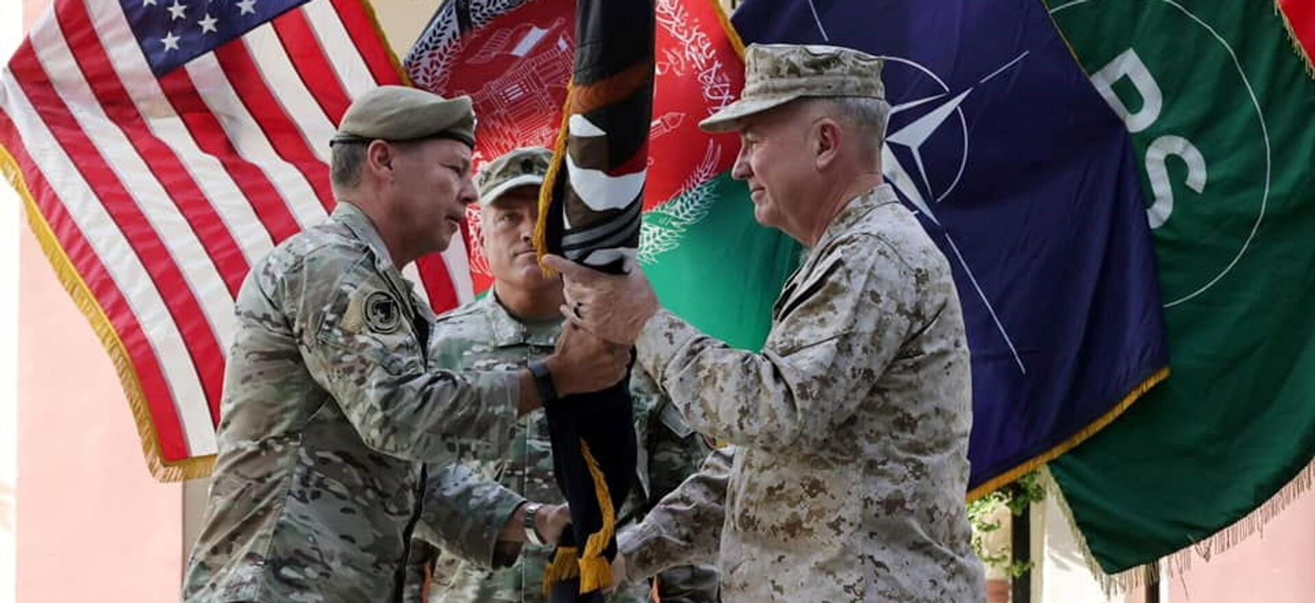 General Austin Scott Miller, commander of U.S. forces and NATO's Resolute Support Mission, hands over his command to U.S. Marine General Kenneth McKenzie, during a ceremony in Kabul, Afghanistan July 12, 2021 - Sputnik International, 1920