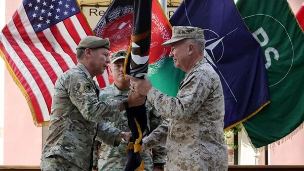 General Austin Scott Miller, commander of U.S. forces and NATO's Resolute Support Mission, hands over his command to U.S. Marine General Kenneth McKenzie, during a ceremony in Kabul, Afghanistan July 12, 2021 - Sputnik International