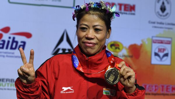 Mary Kom of India gestures with her gold medal after winning the 45-48 kg category final fight at the 2018 AIBA Women's World Boxing Championships in New Delhi on November 24, 2018 - Sputnik International