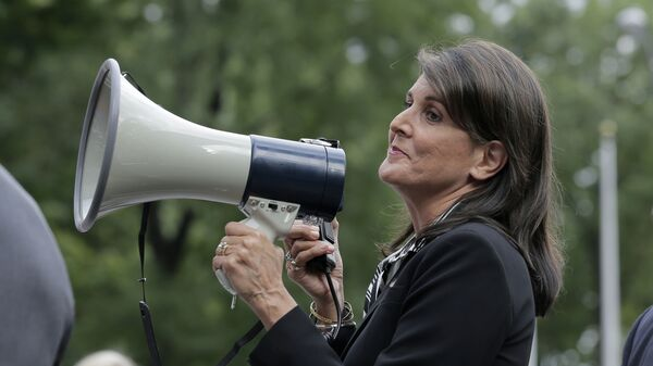 Surrounded by security, United States Ambassador to the United Nations Nikki Haley speaks briefly to people at a protest against Venezuelan President Nicolas Maduro outside United Nations headquarters in New York, Thursday, Sept. 27, 2018 - Sputnik International
