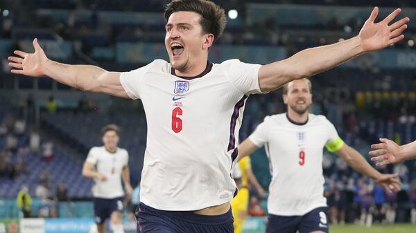 England's Harry Maguire celebrates after scoring his side's second goal during the Euro 2020 soccer championship quarterfinal match between Ukraine and England at the Olympic stadium in Rome at the Olympic stadium in Rome, Italy, Saturday, July 3, 2021 - Sputnik International