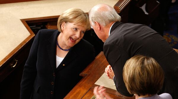 German Chancellor Angela Merkel (L) shares a moment with U.S. Vice President Joseph Biden (2nd R) as Speaker of the House Rep. Nancy Pelosi (D-CA) (R) looks on after Merkel addressed a joint session of the U.S. Congress on Capitol Hill November 3, 2009 in Washington, DC. - Sputnik International