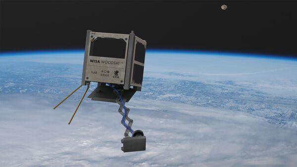 WISA Woodsat, a 10-centimeter cubesat built by Finnish forestry firm UPM, imagined in orbit - Sputnik International