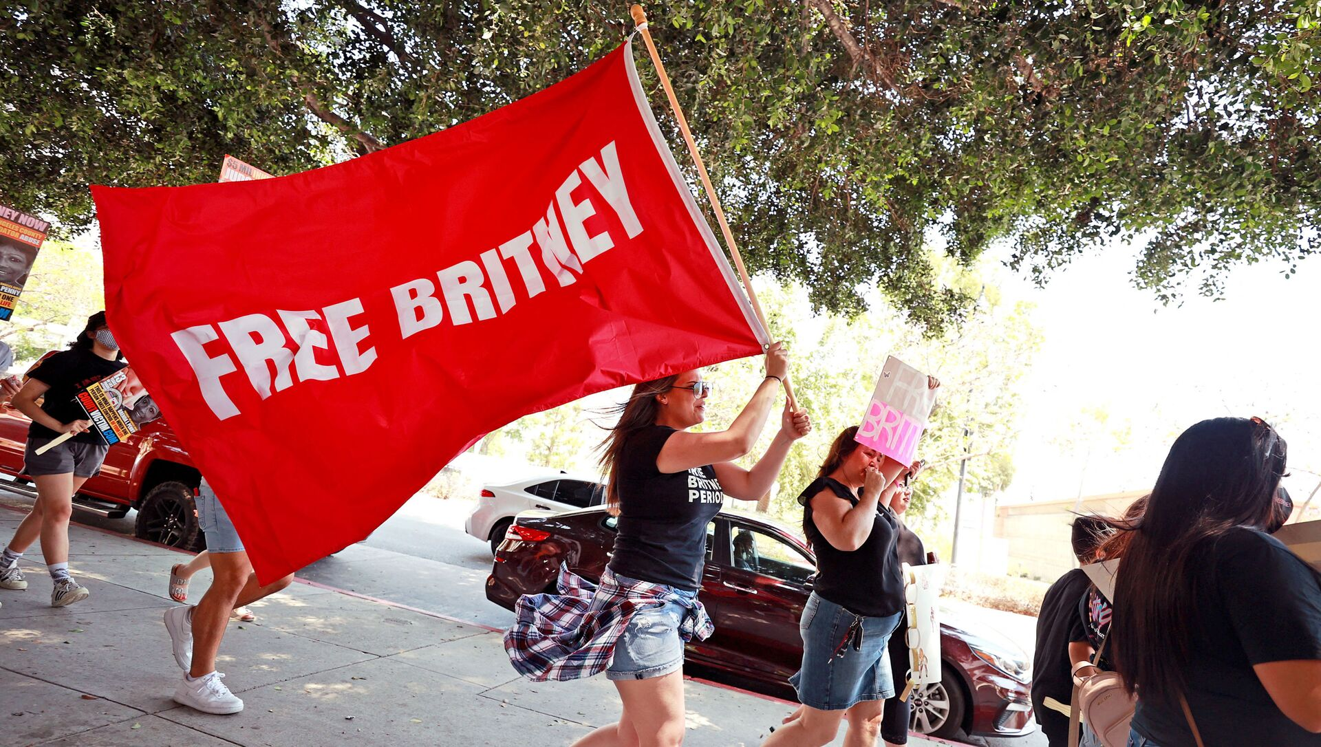 Protesters attend a #FreeBritney Rally at Stanley Mosk Courthouse on 14 July 2021 in Los Angeles, California. The group is calling for an end to the 13-year conservatorship led by the pop star's father, Jamie Spears, and career conservator Jodi Montgomery, who have control over her finances and business dealings. Planned co-conservator Bessemer Trust is petitioning the court to resign from its position after Britney Spears spoke out in court about the conservatorship.  - Sputnik International, 1920, 30.07.2021