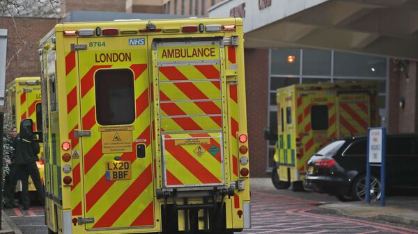 Ambulances are parked at the emergency arrival at Charing Cross hospital in London, Friday, Jan. 8, 2021 - Sputnik International