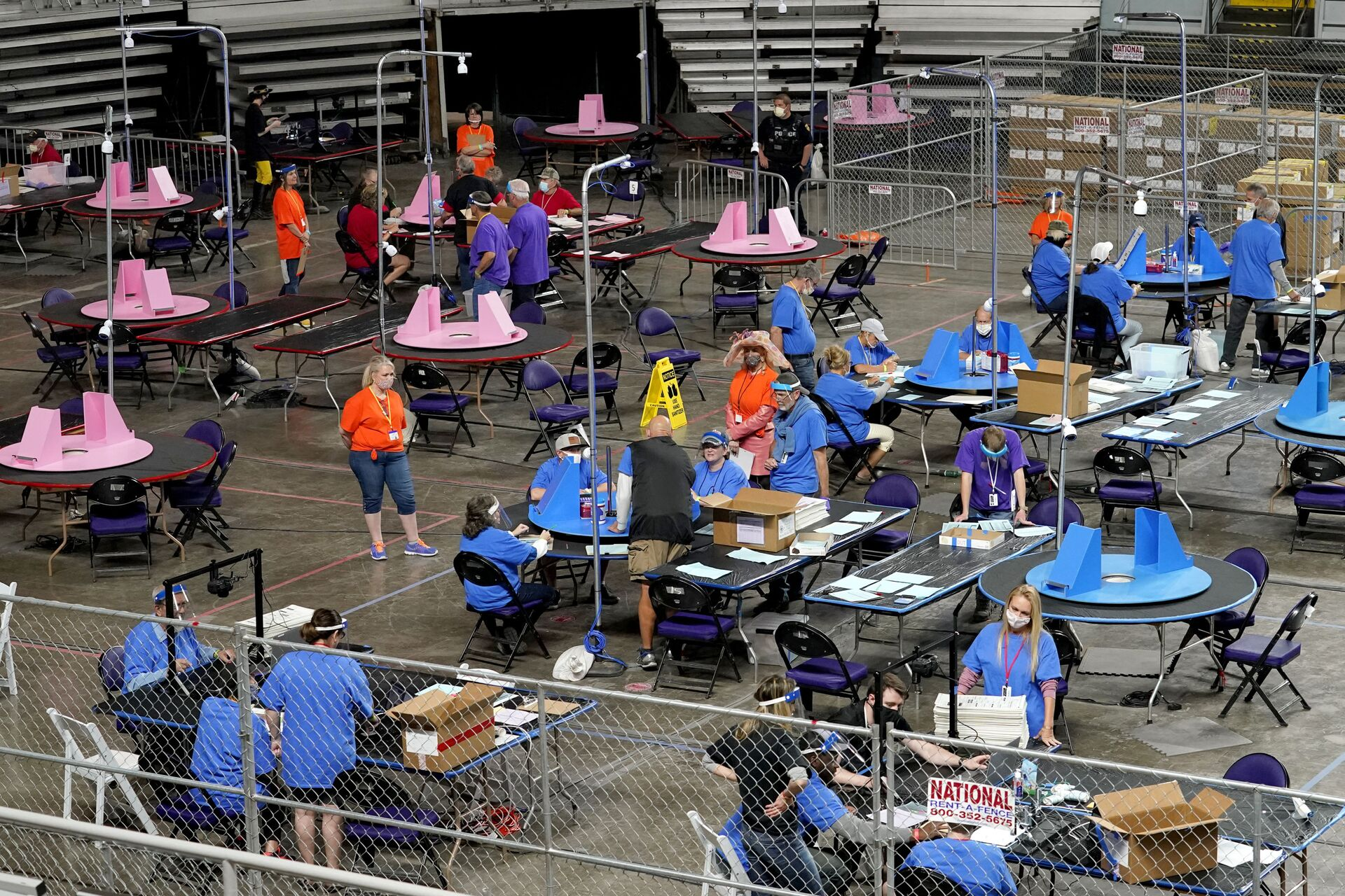 In this May 6, 2021, file photo, Maricopa County ballots cast in the 2020 general election are examined and recounted by contractors working for Florida-based company, Cyber Ninjas at Veterans Memorial Coliseum in Phoenix. Arizona's largest county has approved nearly $3 million for new vote-counting machines to replace those given to legislative Republicans for a partisan review of the 2020 election. The GOP-controlled Maricopa County Board of Supervisors said Wednesday, July 14, 2021 that the machines were compromised because they were in the control of firms not accredited to handle election equipment. (AP Photo/Matt York, Pool, File) - Sputnik International, 1920, 07.09.2021