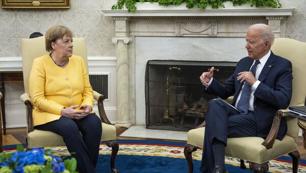 German Chancellor Angela Merkel (L) and U.S. President Joe Biden make brief remarks to the press before a meeting in the Oval Office at the White House on July 15, 2021 in Washington, DC. During what is likely her last official visit to Washington, the leaders are expected to discuss their shared priorities on climate change and defense; and Biden is expected to voice his concerns about the Nord Stream 2 Russian natural gas pipeline. - Sputnik International