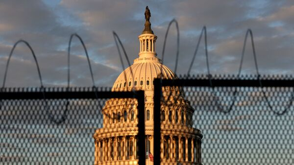 The U.S. Capitol is seen behind a fence with razor wire during sunrise on January 16, 2021 in Washington, DC. After last week's riots at the U.S. Capitol Building, the FBI has warned of additional threats in the nation's capital and in all 50 states. According to reports, as many as 25,000 National Guard soldiers will be guarding the city as preparations are made for the inauguration of Joe Biden as the 46th U.S. President. - Sputnik International
