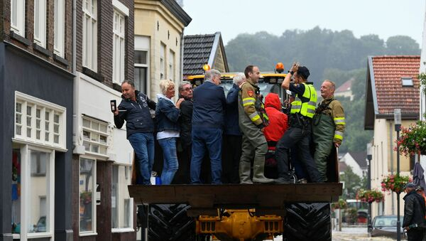 People are evacuated from a flood-affected area, following heavy rainfalls in Valkenburg, Netherlands, July 15, 2021.  - Sputnik International
