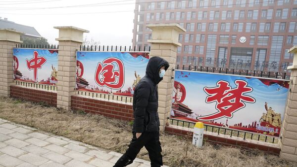A man passes by the words China Dream outside the entrance to the Wuhan Institute of Virology during a visit by a World Health Organization team in Wuhan in China's Hubei province on Wednesday, Feb. 3, 2021 - Sputnik International