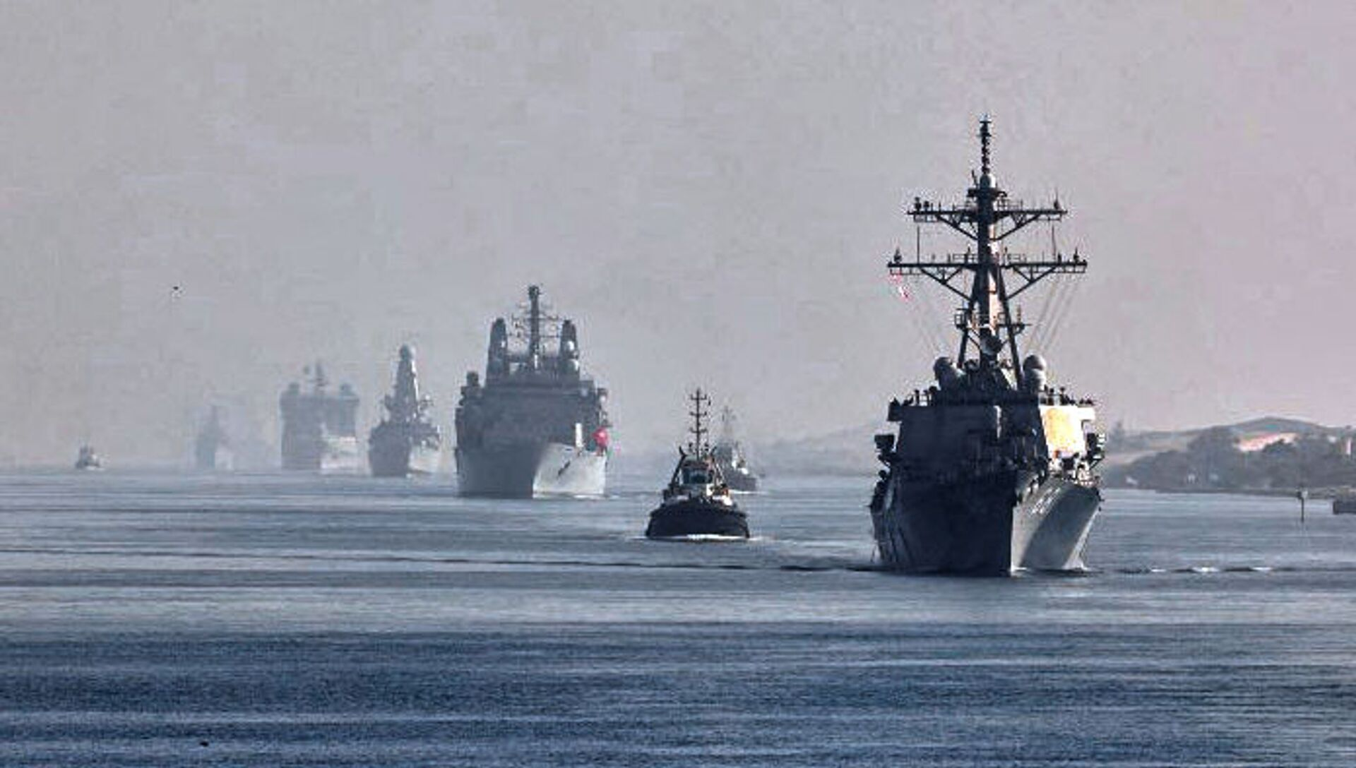 This handout image provided by the official Twitter account of Commodore Steve Moorhouse, Royal Navy, Commander of the UK Carrier Strike Group on July 6, 2021 shows a view of the vessels of the strike group sailing behind the Royal Navy's HMS Queen Elizabeth aircraft carrier through Egypt's Suez Canal. - Sputnik International, 1920, 24.07.2021