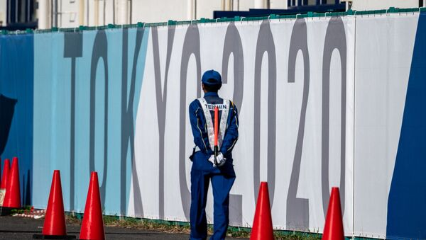 A security guard walks at the Olympic and Paralympic Village in Tokyo on July 15, 2021, ahead of the 2020 Tokyo Olympic Games which begins on July 23. - Sputnik International
