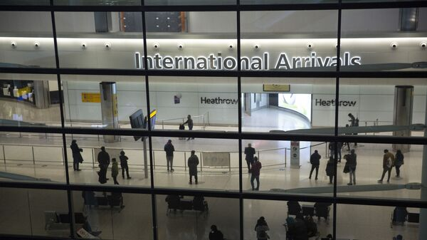 n this file photo dated Tuesday, Jan. 26, 2021, people in the arrivals area at Heathrow Airport in London, during England's coronavirus lockdown - Sputnik International