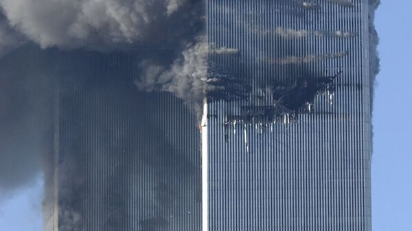 Smoke billows from the North and South Towers of the World Trade Center before they collapsed on September 11, 2001 in New York, NY - Sputnik International