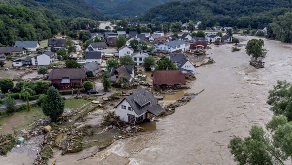 Damaged houses are seen at the Ahr river in Insul, western Germany, Thursday, July 15, 2021. Due to heavy rain falls the Ahr river dramatically went over the banks the evening before. People have died and dozens of people are missing in Germany after heavy flooding turned streams and streets into raging torrents, sweeping away cars and causing some buildings to collapse. - Sputnik International