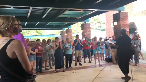 Screenshot from a video allegedly showing Michelle Leete, an ex-vice president of training at Virginia's Parent-Teacher Association, protesting before the Fairfax Schools board, saying that opponents of critical race theory can die - Sputnik International
