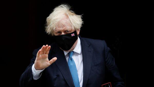 Britain's Prime Minister Boris Johnson walks on Downing Street in London, Britain, 14 July 2021 - Sputnik International