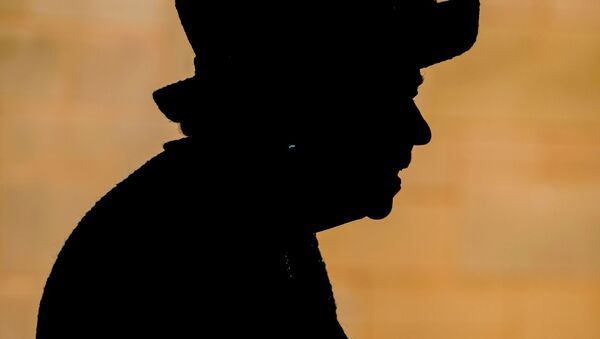 Britain's Queen Elizabeth is seen in silhouette as she visits Manchester Cathedral, in Manchester, Britain, July 8, 2021 - Sputnik International