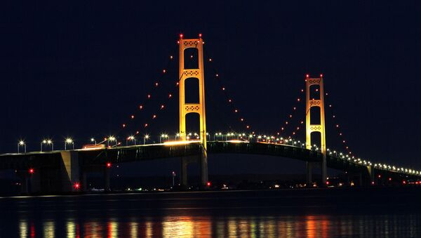 The Mackinaw Bridge July 27, 2008 as seen from St. Ignace, MI.The Mackinac Bridge straddles the Straits of Mackinac connecting Michigan's upper and lower peninsulas. Building it took three years, 2,500 men, 85,000 blueprints, 71,300 tons of structural steel, 466,3000 cubic yards of concrete, 41,000 miles of cable wire and millions of steel rivets and bolts. - Sputnik International