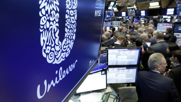 FILE - In this Thursday, March 15, 2018 file photo, the logo for Unilever appears above a trading post on the floor of the New York Stock Exchange. Consumer products giant Unilever, said Thursday July 23, 2020, that second-quarter sales were only slightly lower than the same period a year ago despite the lockdown measures triggered by the global fight against the coronavirus. - Sputnik International