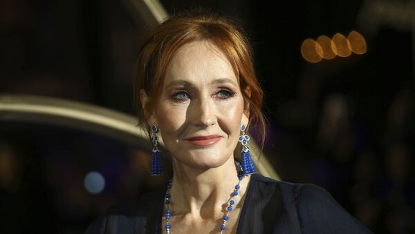 In this 13 November 2018 file photo, author J.K. Rowling poses for photographers upon her arrival at the premiere of the film 'Fantastic Beasts: The Crimes of Grindelwald', in London - Sputnik International