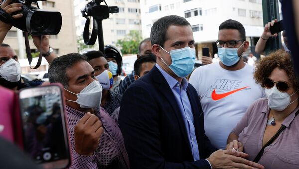 Venezuela's opposition figure Juan Guaido greets people, in Caracas, Venezuela on 12 July 2021.   - Sputnik International
