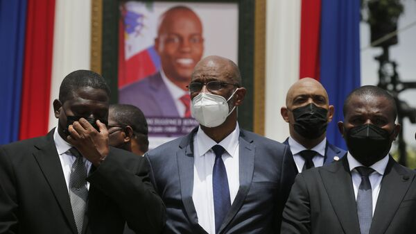 Haiti's designated Prime Minister Ariel Henry, center, and interim Prime Minister Claude Joseph, right, pose for a group photo with other authorities in front of a portrait of late Haitian President Jovenel Moise at at the National Pantheon Museum during a memorial service in Port-au-Prince, Haiti, Tuesday, July 20, 2021. - Sputnik International