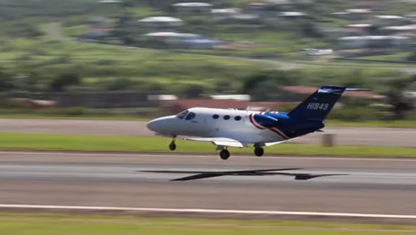 Cessna Citation Mustang HI949, owned by Helidosa in the Dominican Republic, landing on St. Kitts in 2014 - Sputnik International