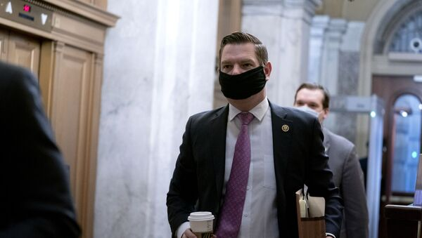 Rep. Eric Swalwell, D-Calif., arrives at the start of the fifth day of the second impeachment trial of former President Trump, Saturday, Feb. 13, 2021 at the Capitol in Washington. - Sputnik International