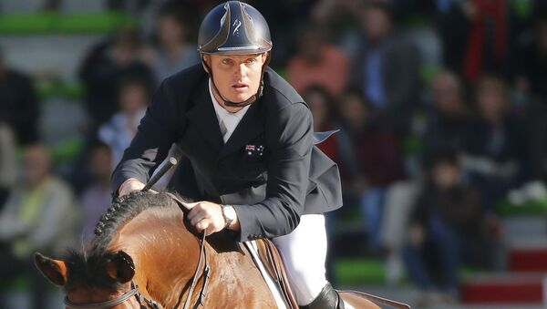 FILE - In this Sept. 3, 2014, file photo, Jamie Kermond of Australia, riding Quite Cassini competes during the second day of the team and individual qualifying show jumping event at the FEI World Equestrian Games in Caen, western France.  - Sputnik International