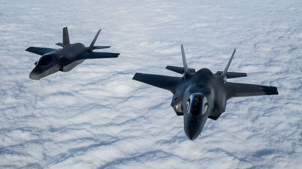 A pair of RAF F-35B Lightning fighter jets flies over The English Channel during the Point Blank exercise after taking off from RAF Mildenhall, Britain, November 27, 2018 - Sputnik International
