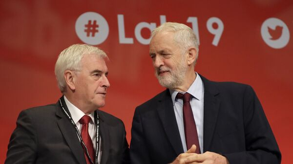 Jeremy Corbyn, leader of Britain's opposition Labour Party, right, and John McDonnell Shadow Chancellor on stage during the Labour Party Conference at the Brighton Centre , Tuesday, Sept. 24, 2019. - Sputnik International
