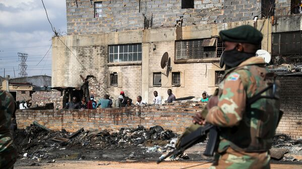 FILE PHOTO: Members of the military patrol through the streets of Alexandra township as the country deploys the army to quell unrest linked to the jailing of former President Jacob Zuma, in Johannesburg - Sputnik International