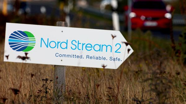 A road sign directs traffic towards the Nord Stream 2 gas line landfall facility entrance in Lubmin, Germany, September 10, 2020.  - Sputnik International