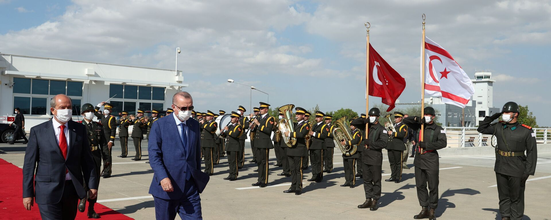 Turkish President Tayyip Erdogan reviews a guard of honour with Turkish Cypriot leader Ersin Tatar before he daparts from the Turkish Republic of Northern Cyprus, a breakway state recognized only by Turkey, in northern Nicosia, Cyprus July 20, 2021. - Sputnik International, 1920, 21.07.2021