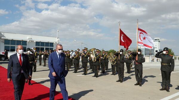 Turkish President Tayyip Erdogan reviews a guard of honour with Turkish Cypriot leader Ersin Tatar before he daparts from the Turkish Republic of Northern Cyprus, a breakway state recognized only by Turkey, in northern Nicosia, Cyprus July 20, 2021. - Sputnik International