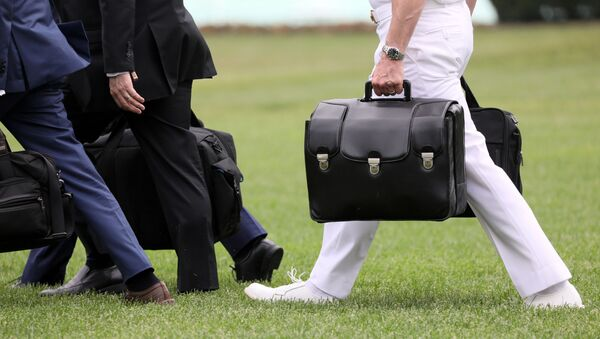 A military aide carries the so-called nuclear football as he walks to board the Marine One helicopter with U.S. President Donald Trump for travel to Florida from the White House in Washington, U.S. May 8, 2019. - Sputnik International