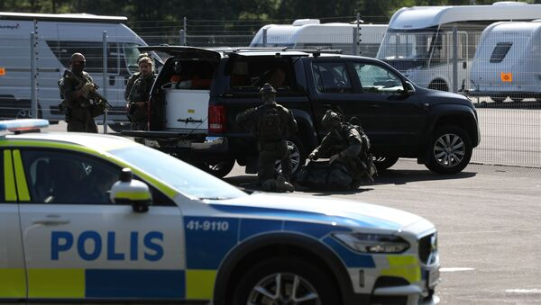 A police vehicle is seen at Hallby Prison, outside Eskilstuna, Sweden July 21, 2021. - Sputnik International