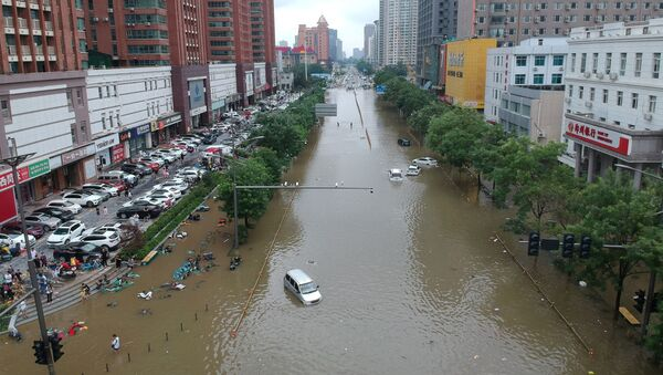 An aerial view shows a flooded road section following heavy rainfall in Zhengzhou, Henan province, July 21.  - Sputnik International