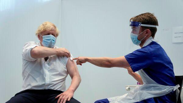 FILE PHOTO: Britain's Prime Minister Johnson receives his second dose of the AstraZeneca coronavirus disease (COVID-19) vaccine, in London - Sputnik International