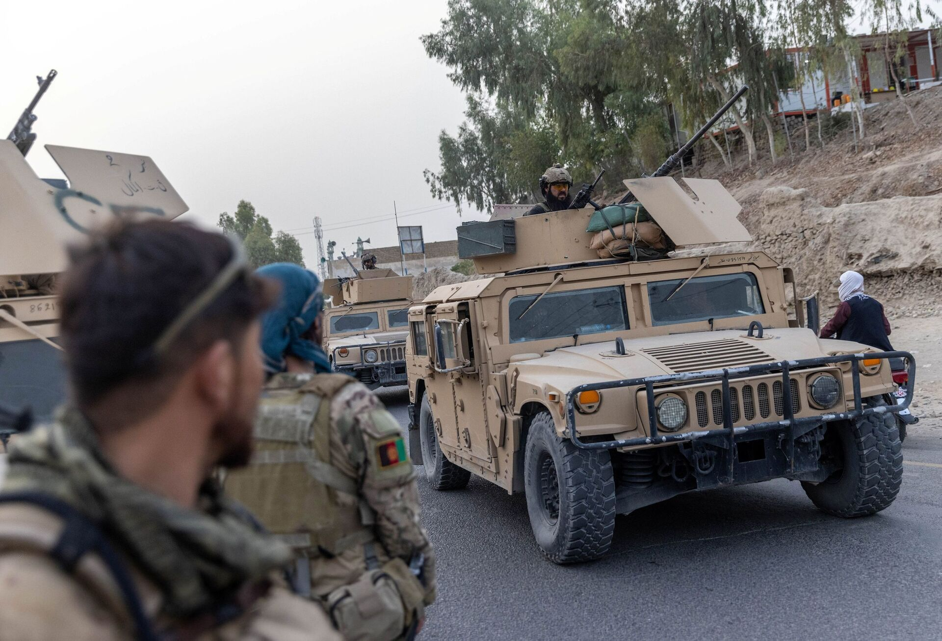 A convoy of Afghan Special Forces is seen during the rescue mission of a police officer besieged at a check post surrounded by Taliban, in Kandahar province, Afghanistan, July 13, 2021. REUTERS/Danish Siddiqui - Sputnik International, 1920, 07.09.2021