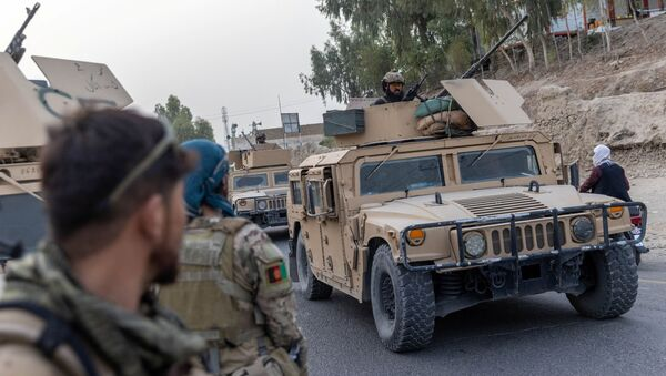 A convoy of Afghan Special Forces is seen during the rescue mission of a police officer besieged at a check post surrounded by Taliban, in Kandahar province, Afghanistan, July 13, 2021. REUTERS/Danish Siddiqui - Sputnik International