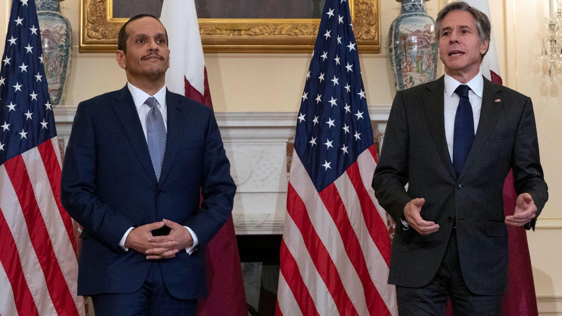 U.S. Secretary of State Antony Blinkin speaks next to  Qatar's Foreign Minister Mohammed bin Abdulrahman bin Jassim Al Thani at Department of State in Washington, D.C., U.S., July 22, 2021. - Sputnik International, 1920, 14.09.2021