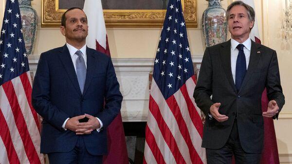 U.S. Secretary of State Antony Blinkin speaks next to  Qatar's Foreign Minister Mohammed bin Abdulrahman bin Jassim Al Thani at Department of State in Washington, D.C., U.S., July 22, 2021. - Sputnik International