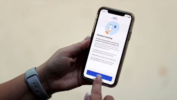 FILE PHOTO: The coronavirus disease (COVID-19) contact tracing smartphone app of Britain's National Health Service (NHS) is displayed on an iPhone in this illustration photograph taken in Keele, Britain, September 24, 2020.  - Sputnik International
